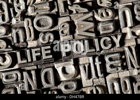 Old lead letters forming the words 'LIFE POLICY' - Stock Photo