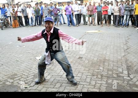 street performer entertaining public Mumbai Maharashtra India - Stock Photo