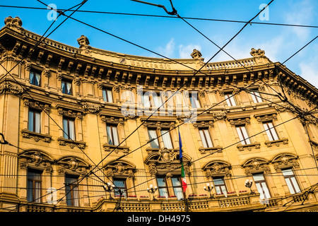 Old building with sunset light in Piazza Cordusio, Milan, Italy - Stock Photo