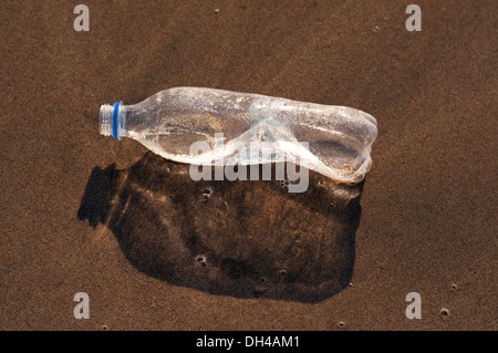 empty plastic bottle on beach sand Maharashtra India Asia - Stock Photo
