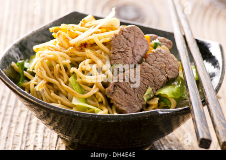 fried egg noodles with beef - Stock Photo
