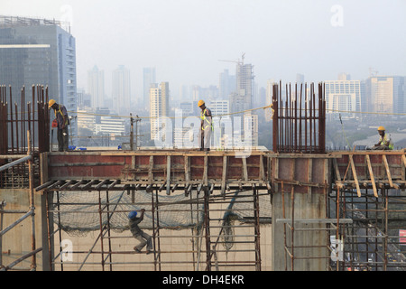 Construction workers working high rise at lower parel Mumbai India - sub 184596 - Stock Photo