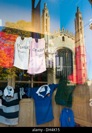 Kings College Chapel Cambridge Uk reflected in a university clothes shop window. - Stock Photo