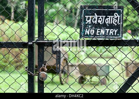 No Entry Signboard on gate at Veermata Jijabai Bhosale Udyan Mumbai Maharashtra India Asia 2012 - Stock Photo