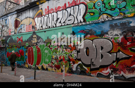 Graffiti in the street, rue Dénoyez, Paris, France - Stock Photo
