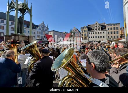 Wind instrument players perform on the market square in Wittenberg, Germany, 31 October 2013. With church services, - Stock Photo
