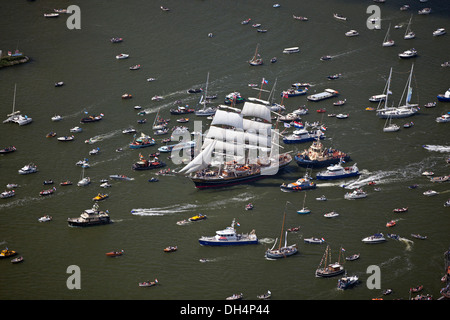 The Netherlands, Amsterdam, sailing event SAIL. Aerial of parade of tall ships. Big sailing boat called Clipper - Stock Photo