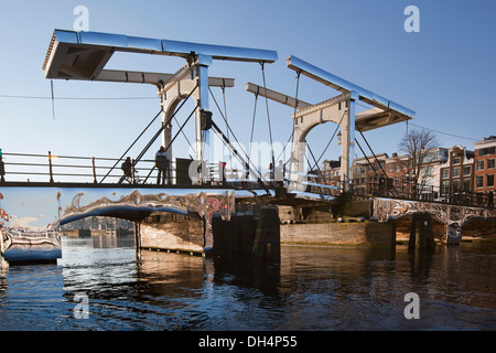 Holland, reflecting artwork 'Amsterdam Light Festival' from Titia Ex called Appears at Amsterdam, on drawbridge - Stock Photo