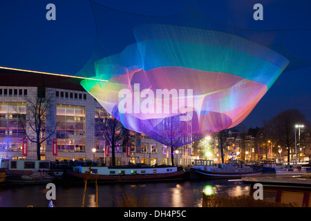 Netherlands, Lightwork during Amsterdam Light Festival from Janet Echelman called Tsunami 1.26 over river Amstel - Stock Photo