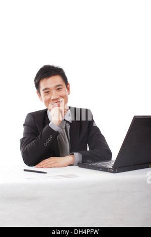 Asian Businessman using Laptop Compute - Stock Photo
