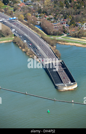 Netherlands, Amsterdam, Zeeburger Tunnel. A10 highway passing underneath IJ lake. Aerial - Stock Photo