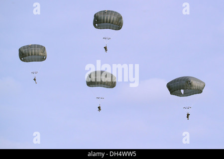 U.S. Army Soldiers, assigned to 173rd Infantry Brigade Combat Team (Airborne), conduct a combat training jump with - Stock Photo