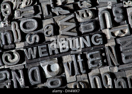 Old lead letters forming the word WERBUNG, German for advertisement - Stock Photo
