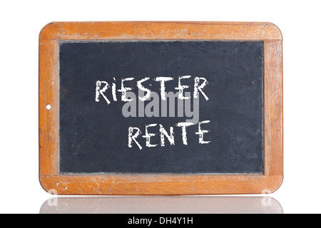 Old school blackboard with the words RIESTER RENTE, German for Riester pension - Stock Photo