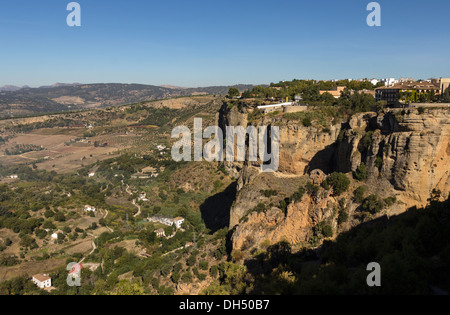 CANYON WALLS OF EL TAJO RONDA ANDALUCIA SPAIN AND VIEW TOWARDS SERRANIA DE RONDA MOUNTAINS - Stock Photo