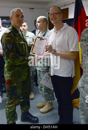 Five soldiers were presented with German Armed Forces Badge for Military Proficiency. SFC David Leake received the - Stock Photo