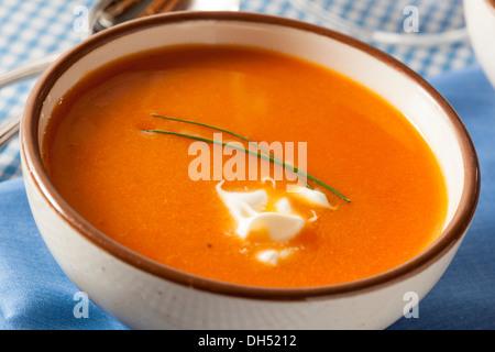 Homemade Orange Carrot Soup with Sour Cream - Stock Photo