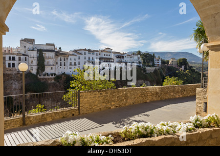 HOUSES OF RONDA OLD TOWN  ALONGSIDE THE EL TAJO CANYON A VIEW FROM THE PARADOR ANDALUCIA SPAIN - Stock Photo