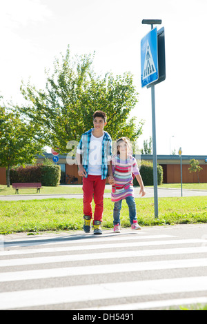 Children crossing a zebra crossing - Stock Photo