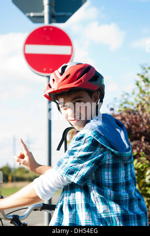 Boy wearing a bike helmet at a traffic awareness course - Stock Photo