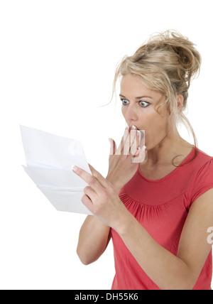 shocked woman getting bad news - Stock Photo