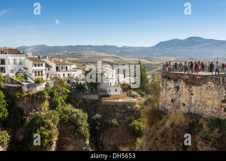 TOURISTS OVERLOOKING THE EL TAJO CANYON OR GORGE IN RONDA ANDALUCIA SPAIN - Stock Photo
