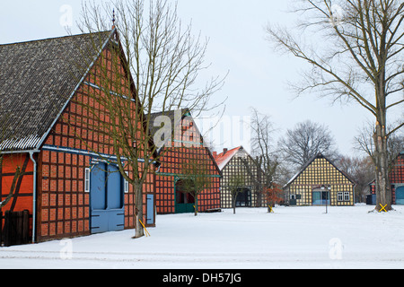 Historic Lower Saxon half-timbered houses in rundling village of Satemin, post-and-beam houses, farmhouses in circular - Stock Photo
