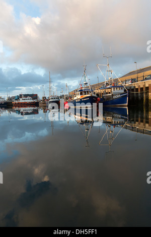 Islands of Orkney, Scotland. Picturesque early evening view of fishing boats tied-up alongside Kirkwall's harbour - Stock Photo
