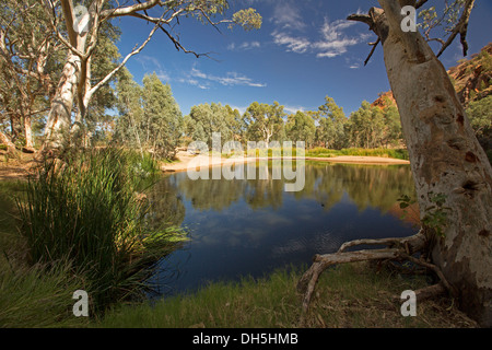 Picturesque outback landscape with blue pool / oasis at Ellery Creek Big Hole in West MacDonnell ranges near Alice - Stock Photo