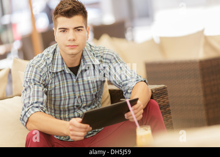 Young man with tablet - Stock Photo