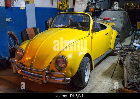 VW Beetle Cabrio, yellow, in a garage, Beirut, Lebanon - Stock Photo