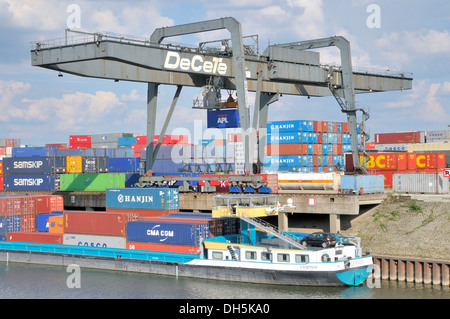 Container ship being loaded, inland port in Duisburg, North Rhine-Westphalia - Stock Photo