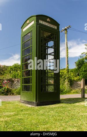 Green version of the British K6 Telephone Box. Portesham, Dorset, England, United Kingdom. - Stock Photo