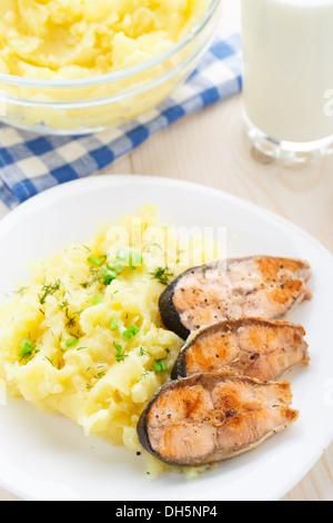 Mashed potatoes with fried salmon - Stock Photo