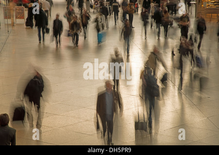 People with blurred outlines, walking in the concourse, Hauptbahnhof, Munich, Upper Bavaria, Bavaria, Germany - Stock Photo