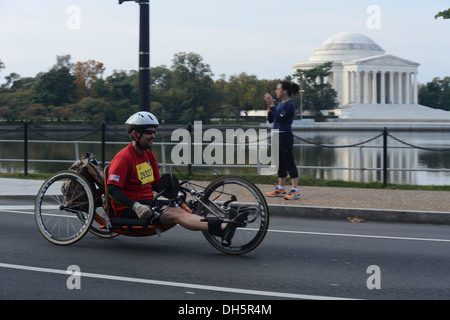 A cyclist participates in the 38th Annual Marine Corps Marathon, Washington D.C., Oct. 27, 2013. Known as 'The People's - Stock Photo