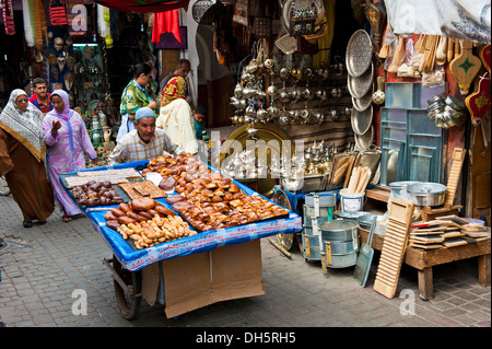 Street vendor pushing a cart with bread and pastries in the souks, bazaar area, Marrakech, Morocco, Africa - Stock Photo