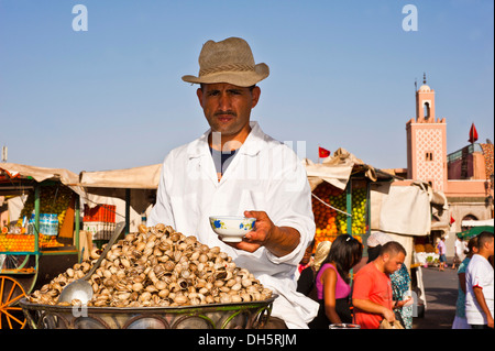 Man selling snails in his cookshop, Djema el Fna square, square of the hanged, Marrakech, Morocco, Africa - Stock Photo
