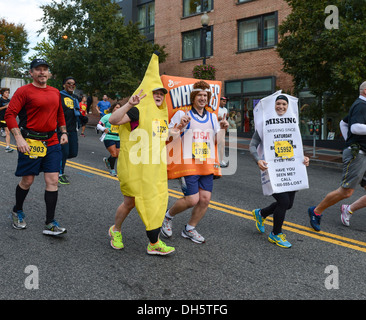 Costumed participants run in the 38th Annual Marine Corps Marathon in Washington D.C., Oct. 27, 2013. Known as 'The - Stock Photo