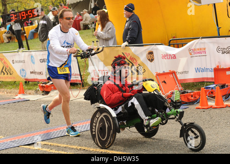 Participants in the 38th Annual Marine Corps Marathon cross the finish together after completing the 26.2 mile course, - Stock Photo
