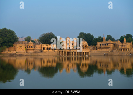 Gadi Sagar, water supply lake with pavilions and temple complexes on the banks, Jaisalmer, Rajasthan, India - Stock Photo