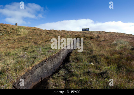 Peat cutting and shieling on the pentland road near Achmore Isle of Lewis Western Isles Scotland UK - Stock Photo