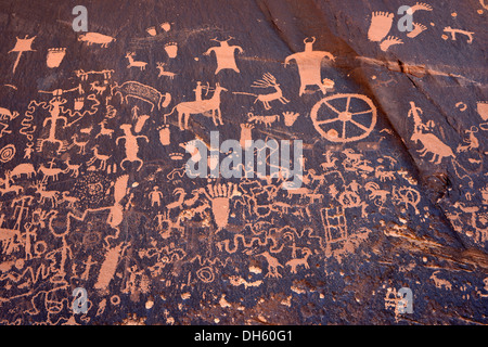 Petroglyphs carved into sandstone, representation of Fremont, Anasazi, Navajo and Anglo-Saxon cultures, prehistoric - Stock Photo