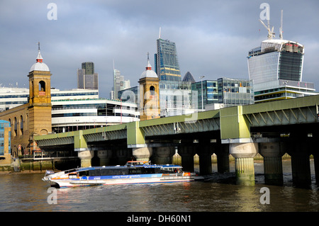 London, England, UK. Cannon Street Station Bridge and the city, seen from the South Bank. 'Thames Clipper' water - Stock Photo