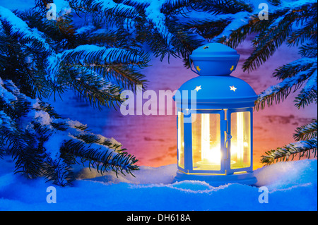 candle light lantern in snow - Stock Photo