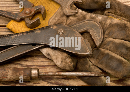 still life with adjustable spanner and gloves - Stock Photo