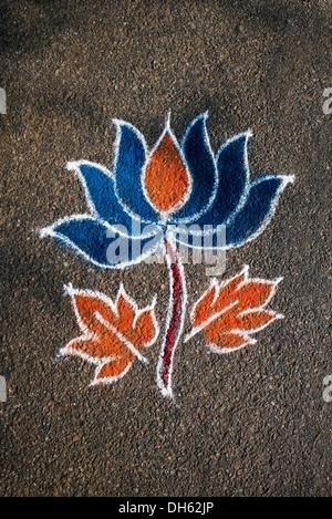 Lotus flower Rangoli coloured powder design in an Indian street. Andhra Pradesh, India - Stock Photo
