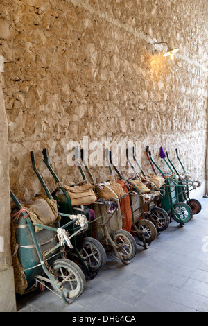 Parking for wheelbarrows, push carts, principal means of transportation in the Souq al Waqif, oldest souq or bazaar - Stock Photo
