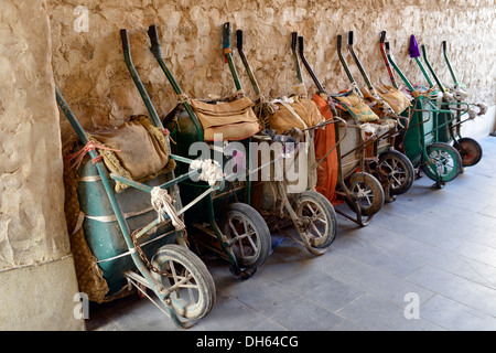 Parking for wheelbarrows, push carts, main means of transport in the Souq al Waqif, oldest souq or bazaar in the - Stock Photo