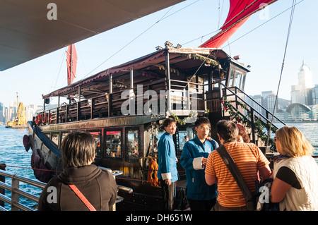 Boarding a traditional junk ship in Hong Kong. - Stock Photo